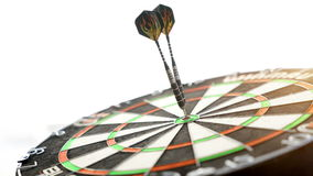 Darts hitting the bulls eye on stock video