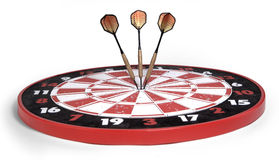 Darts hitting bullseye on white. Darts hitting dartboard bullseyes on white background Stock Images