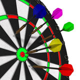 Darts hitting target Stock Photos