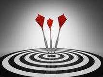 Darts hitting a target Stock Image