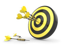 Darts Hitting The Target. Black and yellow Target and Durts isolated on white Stock Images