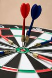 Dartboard. Darts hitting in the target center of dartboard Royalty Free Stock Image