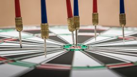 Dartboard. Darts hitting in the target center of dartboard Stock Images