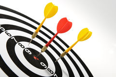 3 darts hitting target center Stock Photos