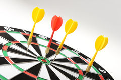 Darts hitting target center Royalty Free Stock Image