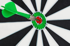 Darts hitting a target close-up Royalty Free Stock Photography