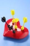 Darts on Loave Heart Royalty Free Stock Photos