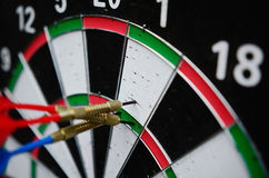 Darts missing the right target. Close up stock images