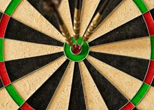 When darts play with three arrows hit the Bullseye royalty free stock images
