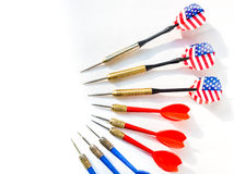 Darts pointing to the same target Stock Images
