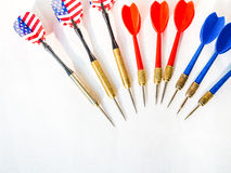 Darts pointing to the same target Royalty Free Stock Image