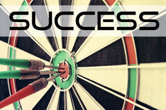 Darts with quote: Success Stock Images