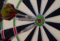 Darts in the red bullseye Royalty Free Stock Image
