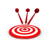 Darts on red target Stock Photos