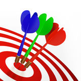 Darts On Red Target Stock Photos