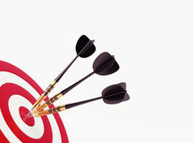 Darts on red target Stock Images