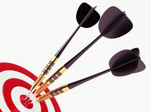Darts on red target Stock Image