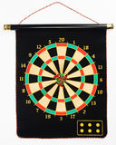 Darts set on a black sheet board Royalty Free Stock Photography