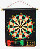 Darts set on a black sheet board Royalty Free Stock Photos