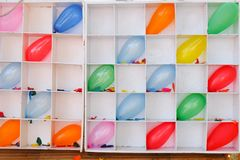 Darts shooting gallery with colorful balloons. In Thai festival Stock Photography