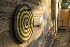 Darts Sign. In a wall Royalty Free Stock Photography