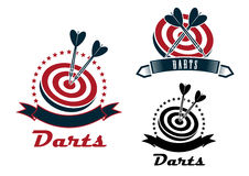 Darts sport emblems or symbols. With a ribbon banner, dart board and darts in different designs, dark grey and red colors Royalty Free Stock Photography