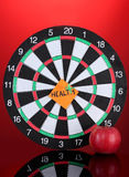 Darts with a sticker symbolizing health Royalty Free Stock Images