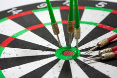 Darts stuck in a board Royalty Free Stock Photos