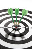 Darts on target Stock Images