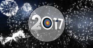 Darts target as 2017 against composite image 3D of fireworks. At night Stock Image