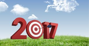 Darts target as 2017 against a composite image 3D of grasslands and sky. Darts target as 2017 against a composite image 3D of grasslands and blue sky Stock Photos