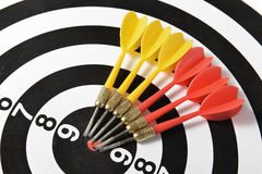 Darts and target center Stock Photo