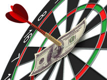 Darts target and 100 dollars. In bulls-eye Royalty Free Stock Photo