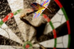 Darts and target. Great Britain tailed dart in colorful target Royalty Free Stock Image