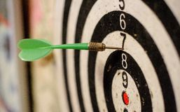 Darts and target green. Vintage photo closeup shot Royalty Free Stock Photography