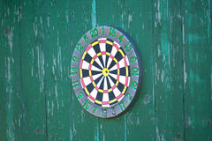Darts target hangs on fence Stock Photography