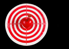 Darts target with heart on black Stock Photos