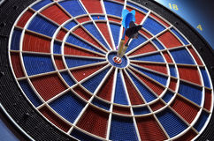 Darts and two arrows in the center. Close-up Royalty Free Stock Image