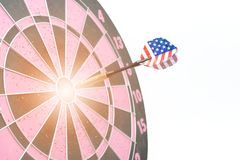 Darts with the United States flag hit the target. On a white background Royalty Free Stock Photography