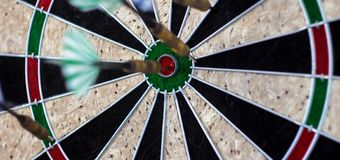 A darts on the wall with dart hit the mark stock photo