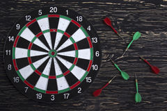 The darts  on wooden background Royalty Free Stock Photos