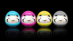 Daruma doll in CMYK color concept in black isolate background. Concept Stock Images