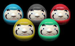 Daruma doll in olympic color concept in black isolate background Royalty Free Stock Photos