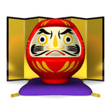 Daruma Doll Sitting On Cushion Stock Photo