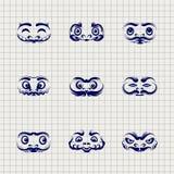 Daruma dolls faces on notebook background Stock Image