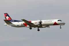 Darwin Airline. PRAGUE, CZECH REPUBLIC - OCTOBER 10: Darwin Airline Saab 2000 lands at PRG Airport on October 10,2013. Darwin Airline is a regional airline with Royalty Free Stock Photos