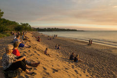 Darwin, Australia May 15 2014 Tourists and locals watch the Mindil Beach sunset. Many people sit and watch as the sun goes down at popular Mindil Beach markets Royalty Free Stock Photos