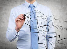 Darwing Diagramme des Geschäftsmannes Lizenzfreie Stockbilder