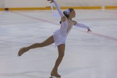 Darya Pazyuk de Ucrânia executa o programa de patinagem livre das meninas da classe III do ouro Fotografia de Stock