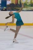 Darya Sopko de Rússia executa o programa de patinagem livre das meninas da classe V do ouro no campeonato nacional da patinagem a Fotografia de Stock Royalty Free